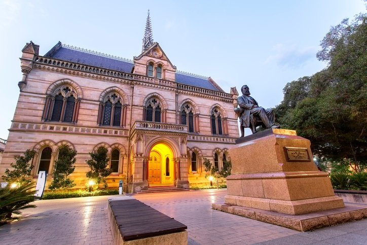 Adelaide, Australia - January 1, 2016: The statue of Sir Walter Watson Hughes (1803–1887), one of the founders of The University of Adelaide, in front of the Mitchell Building, which is the first building erected for the university, on the North Terrace.